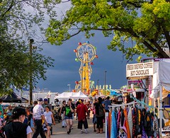 A Day At The Fair (Wes Iversen) Tags: trees people men clouds children tents women fairs michigan ferriswheels carnivals carnivalrides davisburg oaklandcountyfair nikkor18300mm
