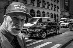 (Damien Sass) Tags: manhattan streetphotography newyorkcity nyc people urban usa unitedstates america makeamericagreatagain politics donaldtrump elections 2016 fujifilm 28mm cap hat red 5thavenue 57thstreet
