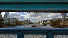 London framed by Tower Bridge (lunaryuna) Tags: naturalframing urbanlandscape london riverthames architecture city urbanviews towerbridge adifferentkindofframing panorama hmsbelfast thamesclipper river boats transport tower pier lunaryuna