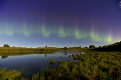 the light fantastic July 20 (John Andersen (JPAndersen images)) Tags: morning sky night reflections reeds stars pond july calm alberta aurora