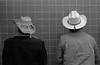 Bathroom Cowboys (AnniversaryRoad) Tags: 50mm bw canada delta ft2 ilford manitoba nikkormat nikon nipponkogaku winnipeg analog bathroom black blackandwhite cowboy cowboys film hat hats jacket men monochrome two urinal urinals white surreal indoor university