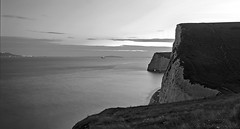 nightfall over Dorset cliffs and Jurassic Coast (lunaryuna) Tags: uk england dorset coastcoastline cliffs chalkcliffs buffs jurassiccoast lulworth sea nightfall dusk citylights weymouthatthehorizon ship le longexposure water lightmood lunaryuna