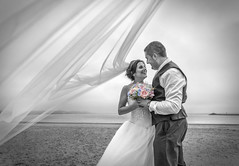 Ceri & Owain (Ffotograffiaeth Dylan Arnold Photography) Tags: mono colourpop beach creative overcast veil blowing flowing couple justmarried marriage husband wife weddingday happy inlove flowers