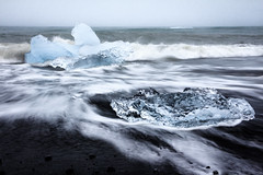 Black & Ice (loddeur) Tags: ijsland jokulsarlon ice black beach iceberg glacier ijs schotsen longexposure filter nd8 waves sea iceland cliche classic contrast tourism seascape coast wild movement blur