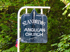 Weathered Balloons (Steve Taylor (Photography)) Tags: st saint andrews anglican church balloon weathered cobweb web cross post pole corroded sign black green white metal newzealand nz southisland canterbury bankspeninsula tree branch
