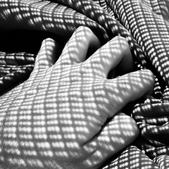 Scales (okenri) Tags: whirl vortex eddy dots spots light hand sheet waves wavy grasp winding pattern