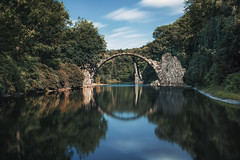 Rakotzbrcke (digital_underground) Tags: bridge water longexposure reflections lake trees tree sky clouds stone green blue