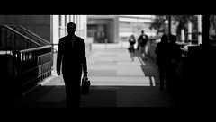 Five O'Clock Shadow (Beatdownius) Tags: street corporate blackwhite streetphotography suit cinematic suitcase 135mm whitecollar