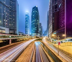 Pulsating [] (t3cnica) Tags: city longexposure urban panorama building architecture hongkong landscapes downtown central cityscapes structure financialdistrict ifc dri starburst nightscapes lighttrail sheungwan leadinglines dynamicrangeincrease exposureblending digitalblending internationalfinancecentre hongkongifc