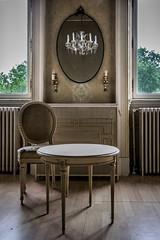 In this Dutch castle (Channed) Tags: castle kasteel mirror spiegel chair stoel nederland thenetherlands abandoned urbex verlaten urbanexploration urbanexploring upc0516 urbanphotocollective chantalnederstigt