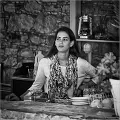The coffee girl (John Riper) Tags: johnriper street photography straatfotografie square bw black white zwartwit mono monochrome candid john riper canon 6d 24105 l cyprus  coffee girl fashion smile bar lamp light
