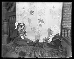 Girls on a porch with a kitten - glass negative #1 (sctatepdx) Tags: victorian victorianchildren victorianclothes victoriancoat victorianbonnet kitty kitten cat decorativescreen victorianscreen glassnegative antiquecamera buttonupshoes tabbycat tabbykitten