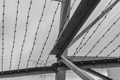 DSC_2138 (Holt MeCloser) Tags: architecture lines black white barbed wire power line bw