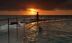 Sunrise Bronte Baths (sugarbellaleah) Tags: morning light sea orange sun sunlight texture beach water pool silhouette clouds contrast swimming swim sunrise seaside waves exercise ripples railing fitness bronte rockpool