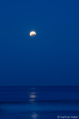 Lunar Eclipse Over The Pacific - 2979 (www.karltonhuberphotography.com) Tags: longexposure nightphotography light shadow sky moon nature vertical reflections outdoors dawn pacific exploring horizon line special pacificocean mysterious astronomy southerncalifornia sanclemente naturalwonder lunareclipse naturephotography 2015 sanclementecalifornia silkywater nikond7000 karltonhuber