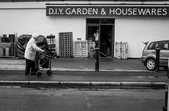 2016_196 (Chilanga Cement) Tags: street blackandwhite bw lady shopping garden walking fuji pavement walk housewares sidewalk ormskirk xseries x100 x100s x100t fujix100t