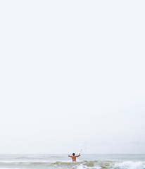 White Out Fisherman (Zach_Woolf) Tags: beach florida fish fisherman wildlife ocean waves human portraits fishing oceanfishing beachfishing canon outside canon5f