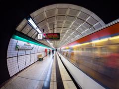 Hamburg tube (uneitzel) Tags: architecture architektur bahnhof fisheye hamburg metro olympusem5 samyang station ubahn walimex75mm bewegungsunschrfe messehallen motionblurring subway vanishinglines dynamic traffic