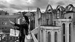 Selfie in Lisbon (Inge Vautrin Photography) Tags: carmoruins carmoconventruins lisbon lisboa portugal europa europe pastisdebelm city urban ruins girl people person selfie selfiestick photographer photography monochrome bw blackandwhite view streetphotography street tourism tourist visiting architecture
