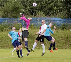 Mark Wilson flaps at the high ball as Nicky Little lurks in the background (Stevie Doogan) Tags: clydebank glasgow perthshire exsel group sectional league cup wednesday 10th august 2016 holm park