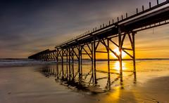 sunlit pier (Steven Peachey) Tags: uk sea england sun beach sunrise canon reflections golden coast pier sand exposure waves lee filters hartlepool northeastcoast ef1740mmf4l lee09gnd canon6d steetleypier hawkdog
