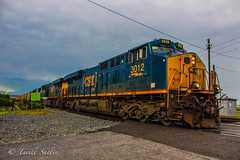 CSX E004 departing Tampa, FL 7-24-16 (tarellsallie) Tags: tampa florida tampabay hillsborough hillsboroughcounty centralflorida july 2016 usa unitedstates america canon canont3i copyright lightroom cloudy rain rainy nature rocks grass powerlines road headlights engine locomotive train trains railroad railroadcrossing csx ns cn cp up bnsf kcs unionpacific canadianpacific norfolksouthern canadiannational es44ac es44dc et44ac sd70 sd70mac sd70ace sd40 sd50 sd60 ge emd electromotive generalelectric blue yellow gold fuel howtomorrowmoves coal coaltrain powerstation powerplant energy urban metro rural