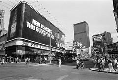 Time Square 1981 (iswimintime) Tags: newyork unitedstates us nikkormat kodak trix film photography vintage photo architecture historical building city life new york manhattan usa nostalgia street streetphotography blackandwhite bnw monochrome monoart monotone monochromatic noir fineart