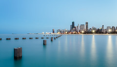 Chicago Lakefront (One_Penny) Tags: city longexposure blue light sky urban usa lake chicago blur water colors lines skyline architecture america skyscraper reflections photography evening town illinois exposure cityscape waterfront dusk lakemichigan shore bluehour lakefront