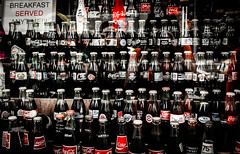 Bottles in the window (OneMarie!) Tags: coke cocacola beverage bottles window nyc ny newyork botellas vitrina nikon d5000 ciudad city clsico classic traditional icono icon