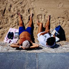 'Le Naf Libertin' (nelsongedalof) Tags: street summer sun colour beach reading sand couple 28mm tan streetphotography streetphoto gr ricoh biarritz colorstreetphotography candidandstreetphotography nelsongedalof