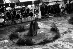 B&W 35mm (sarahabramson) Tags: creepy scary cloaked camera art spooky goth fine contemporary photography female photographer graffiti street tagging circles symbols haunted black white