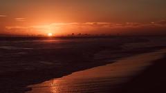 Red (demandaj) Tags: sunset ca california longbeach bolsachicastatebeach socal silhouette ocean waves nikon 85mm f8