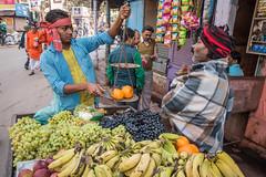 Fruit seller (Richard McGuire) Tags: india fruit market varanasi oranges uttarpradesh
