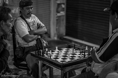 Chess in the street ! (Helmiyousif) Tags: life street travel shadow sky people blackandwhite bw woman white abstract man black streets reflection men art cars buildings photography landscapes photo women faces photos walk background homeless stock chess cities culture traditions lifestyle tourists elderly roads items streetchess microstock chessinthestreet coubles