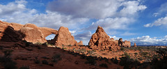 Grand - North Window Panorama (Drriss & Marrionn) Tags: travel roadtrip lasal utah usa landscape outdoor blueskies cloud clouds sky skies rock mountain mountains canyon mountainside sandstone nature red crag cliff archesnationalpark moab rockformation arch naturalarch turretarch peak