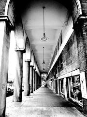 Pillars and Lamps in Essen (Saromat (photographs by Sarah B.)) Tags: pillars lamps essen germany deutschland ruhrgebiet blackandwhirte bw bnw essencity ruhrpott sulen lampen strase street pavement brgersteig pointofview