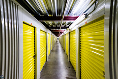 Infinite Storage (PhotonLab) Tags: storage garage infinite illusion hallway sony sonya7ii fullframe 28mm yellow industrial selfstorage doors