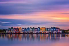 Rainbow Houses (albert dros) Tags: rietplas houses sunset albertdros reflections town clean longexposure rainbow dutch travel thenetherlands houten village tourism bluehour smooth