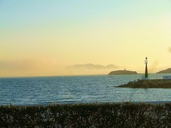 fog over Ibiza harbour & Playa d'en Bossa (helenoftheways) Tags: ibiza harbour fog mist lighthouse med sea baleares spain blue hills eivissa bruma
