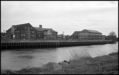 The River and the Old Wharf Buildings, Gainsborough (tatrakoda) Tags: old uk england urban bw building history monochrome architecture 35mm river geotagged mono town blackwhite nikon riverside lincolnshire warehouse trent wharf epson analogue v600 f5 grade2 listed gainsborough dn21