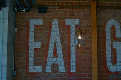 Strong Suggestion (MPnormaleye) Tags: wood light brick wall bulb restaurant words paint letters ad diner retro advertisement textures eat utata dining