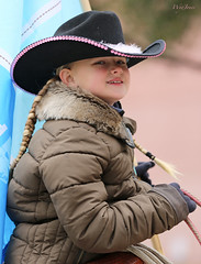 Old Enough To Ride (wyojones) Tags: cute girl beautiful smile hat hair pretty texas flag coat houston rope parade gloves blonde cowgirl lovely saddle braid pigtail houstonlivestockshowandrodeo cowgirlhat hatband trailrider wyojones houstonlivestockshowandrodeoparade