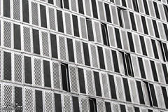 Open patterns to change (Tsundere_Tikor) Tags: city windows blackandwhite white abstract building tower texture textura monochrome lines wall architecture pattern open close geometry surreal abierto cerrado minimalism guides arquitecture simetry monocromatico