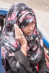 H504_3494 (bandashing) Tags: girl headscarf hijab burkah niqab cover black street sylhet manchester england bangladesh bandashing socialdocumentary aoa akhtarowaisahmed talk phone floral