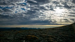 calming (daynawines) Tags: clouds landscape sky low ground rocks