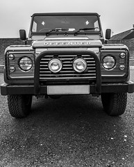 Land Rover Defender (kerryn rice) Tags: uk england bw white wheel grey lights countryside mud cab country guard rover dirty land landrover defender