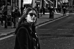 Beautiful brunette with sunglasses and duffle coat  IMG_3013-Edit (roger_thelwell) Tags: life street city uk winter portrait england people urban bw white black streets cold london lamp monochrome beautiful westminster beauty hat sunglasses rain leather mobile umbrella hair bag walking real photography mono chat shiny phone with traffic post natural photos britain circus cigarette candid cab taxi coat great sac hats cell photographic smoking lamppost photographs oxford conversation shiney brunette talking shoulder handbag stud speak speaking studs commuters duffle