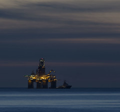 Evening Lights (Dot 'n Dave) Tags: sea cloud canon lights evening scotland rig oil banff layers striations