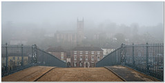 Before the visitors arrive (Hugh Stanton) Tags: bridge hotel fog mist town fence ironbridge