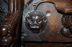 Minster in Thanet, Kent, St. Mary's church, choir, stalls, north side, misericord # 6, detail (groenling) Tags: minster thanet kent england britain greatbritain gb uk stmaryschurch stalls misericord wood carving woodcarving supporter face tongue grotesque